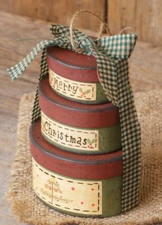 Stacked nesting boxes tied together with ribbon Primitive Christmas, Country Christmas, Christmas Crafts, Merry Christmas, Christmas Decorations, Holiday Centerpieces, Paper Mache Boxes, Painted Hats, Country Paintings