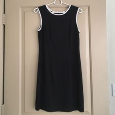 CDC Black Dress Vintage fitted black dress with white trim around neckline by CDC Caren Desiree Company. Zipper in back, fully lined. Tag says size 8 but fits like a women's 4 Caren Desiree Company Dresses
