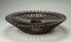 Basketry, Tanabe Chikunsai III (previously Shochiku), Artist, Flower Basket, Core, 1969  Bamboo (yadake and madake) and rattan  Selected techniques: parallel construction, square plaited base (upper), diamond twill plaited base (underside), H. 9 1/2 in x Diam. 24 in., Photograph by Kaz Tsuruta