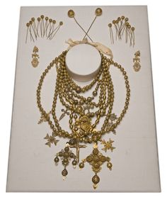 Salamanca, Spain, 19th Century, Parure consisting of eighteen hair pins, one pair of earrings, six necklaces, the largest of which has 5 pendants. It is made of gold filigree silver and gold, decorated with seed pearls.