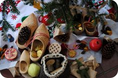 "St. Nicholas Day - December 6.  ""Three pairs of wooden shoes...notice the delicate carving marks.... beautiful ribbons of gingham....simple gifts....oranges represent the sweetness of our spirits, golden coins represent giving to each other.  A new ornament in memory of this year's celebration sits in each child's shoe. A large pine cone to roll in peanut butter and seed...for the birds.""  Pinned by www.mygrowingtraditions.com"