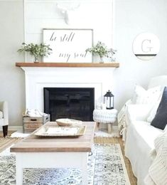 100 Charming Farmhouse Living Room Ideas to Try at Home - living room decor idea with a rustic coffee table and mantel decor. Brick Fireplace Mantles, White Fireplace, Farmhouse Fireplace, Living Room With Fireplace, Home Living Room, Living Room Designs, Fireplace Ideas, Wood Mantle Fireplace, White Mantle