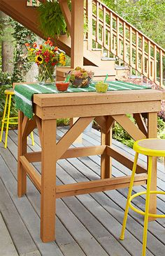 Indulge sports-bar-style snacking and dining outdoors by building a simple pub table in a design that complements existing deck framing and supports. For an even more consistent look, stain the tall table to match the color of the deck and other outdoor furniture pieces.