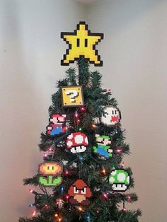 Make your home a happy home for the holidays with this Super Mario Bros. Star Tree Topper has a STRONG support hot glued in the back. *Made with Perler Beads and Love :) **Need Stocking Stuffers?** **check out my lighter cases! Diy Xmas, Diy Christmas Tree Topper, Unique Christmas Trees, Noel Christmas, Xmas Tree, Christmas Ornaments, Funny Christmas, Holiday Tree, Star Tree Topper