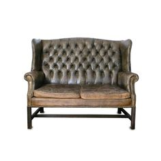 Georgian style two seat settee/ sofa deep buttoned antique green leather upholstery with two fitted cushion seat (SETL10008) Available to hire please visit www.farley.co.uk for further information.