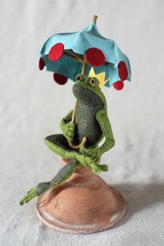 The meticulous work that goes into this wee felt umbrella project from Cynthia Treen is beautiful and impressive. She's shared the pattern and step-by-step tutorial over on The Crafts Department. The umbrella is an accessory to an adorable felt frog prince pattern she also created. He looks so dapper with it sitting on his shoulders!