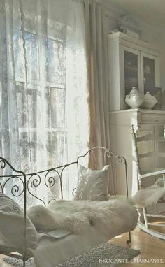 ~~~~I love the day bed here and the all white decor.  Plus, ironstone on the cupboard is indeed lovely~~~~