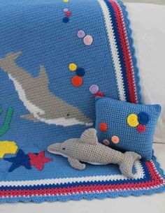 "Watch Maggie review this adorable Dolphin Afghan Pillow & Toy Crochet Pattern! Design By: Mary Pueschner Skill: Intermediate Size: Afghan: approx. 39"" x 46"""