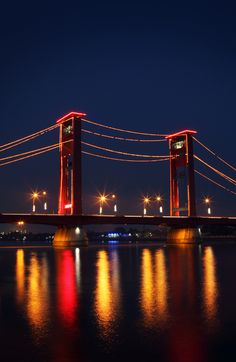 The Ampera bridge in Palembang with The Royal Colors Red and Gold. The ghostwalkers took a break here after Draden and Shylah were healed and on their way home Visit Singapore, Royal Colors, Dutch East Indies, River Bank, Palembang, Padang, Romantic Places, Culture Travel, Archipelago