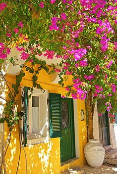 House covered In Bougainvillea, Paxos, The Ionian Islands, Greek Islands, Greece, Europe