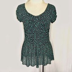 """Postmark Green Polka Dot Top✨Host Pick✨ Sweet peplum top by Postmark (9-H15) from Anthropologie. Green polka dots on a gray almost navy blue background. The bodice is gathered in the front and back and lined. The sleeves and peplum are unlined; hem is raw.  Fabric is a polyester mesh so it has stretch. Size Medium. Bust: 15"""" across, unstretched. Length: 25"""" Anthropologie Tops"""