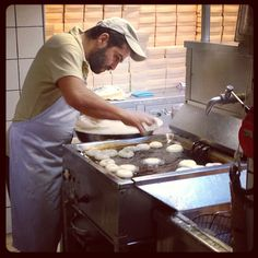 Making Loukoumades (Greek donuts) at a 100+ years old pastry place in the Historic centre