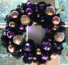 Black Christmas wreath with puple & gold ornaments. I love non-traditional Christmas decor!