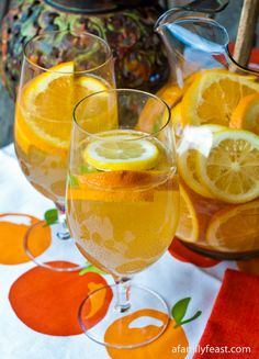 White Wine Sangria recipe with white wine, ginger ale, oranges, lemon and limes. Snacks Für Party, Party Drinks, Cocktail Drinks, Fun Drinks, Alcoholic Drinks, Beverages, Summertime Drinks, Summer Drinks, Paella