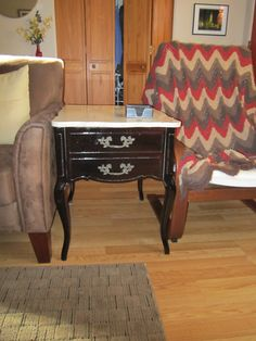 Refinishing Tables: Look at estate sales for great steals. This table is one of set that I got. I used Minwax Brazilian Rosewood Gel Stain over a smoke stained white finish the table came with. Make sure to sand down tables before staining and if possible remove paint first.