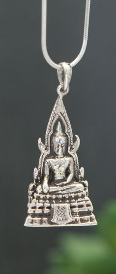 Buddha's renowned features are rendered in extraordinary detail in a shimmering mother of pearl pendant set in sterling silver. Buddha Jewelry, Decorative Bells, Sterling Silver Pendants, Symbols, Crafts, Spiritual Awakening, Bracelets, Manualidades, Handmade Crafts