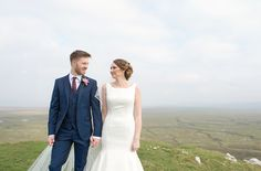 "Rachel & Jon embraced my enthusiasm for a ""mini adventure"" which involved leaving the smooth tarmac road for a spot of off-road driving, wellies, sheep & a little dog that befriended us! The rocky road lead us to one of Gower's hidden gems with a breathtaking view over the marsh lands. This beautiful dramatic wedding photo was the result, it's full of love and passion.Gallery @ www.flashbulb.info/swansea-wedding-photography-blog/fairyhill-wedding-photographer-rachel-jon"
