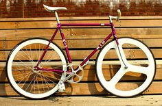 Bright magenta with RIH fixie with hybrid rims...