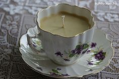"""go to the salvation army """"as is"""" shop and pick up tea cups and mismatched saucers.  create your own color scheme and then add homemade lavender beeswax candle"""