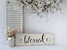 "■■Choose from over 70 lettering colors■■  Overflowing in grace, this exquisite rustic wooden ""blessed"" sign perfectly sums up your thankfulness and gratitude in one simple word. Handcrafted using only the finest materials, it features a pine wood base painted with latex and hand lettered text in a flowing font that is sophisticated to say the least. It has saw-toothed hangers on the back which make adding it to your existing décor a breeze. Give a gift that will keep on giving with this…"
