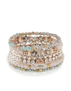 Threaded on elastic for fuss-free styling, our Kyoto beaded bracelets have the luxe look mastered. Accents of rose gold-tone metal, crystal gems and flower c...