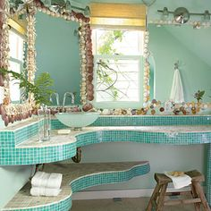 Go with the Flow - Our Best Beach Baths - Coastal Living Rounded edges and a tropical colour scheme turned this bath into an oasis. Scallop shells frame the master bath mirror, and mini aqua tiles line the sink and spa tub. The wavy lines of the tiled surfaces create the feel of moving water.