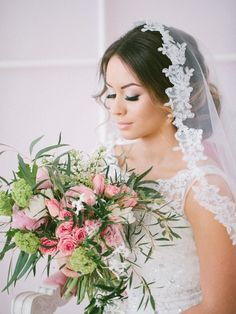 elegant wedding updo with veil / http://www.deerpearlflowers.com/beautiful-wedding-hairstyle-ideas/