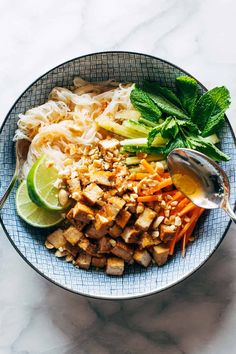 Lemongrass Vermicelli Salad - a summer showstopper! A twirl of vermicelli noodles, pan-fried tofu, fresh herbs and veggies, and a lime-and-lemongrass-based sauce that just slips all over the plate. #salad #lemongrass #mealprep
