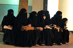 "Saudi women waiting for drivers outside a shopping mall. Women are not allowed to drive because driving leads to "" too many freedoms for women, that lead to social problems""."