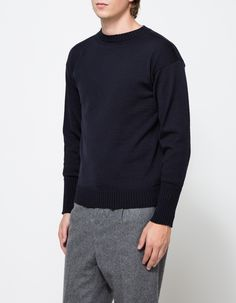 From ANDERSON-ANDERSON, a classic heavy weight wool sailor sweater in a deep blue. Featuring a deep navy, 100% merino wool, gauge 7 single knit, ribbed neckline, 2x2 ribbed cuff, thumbholes at cuff, ribbed hem, and a modern slim fit.   •  Heavy weight s