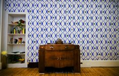 The flower and the wall hand paints and design wallpaper...love the pattern and color scheme