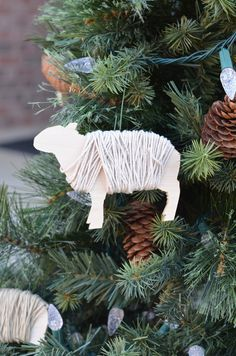 DIY Sheep Christmas Ornaments -- If I can find a way to do this out of heavy cardboard, we might be in business...