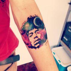 Galaxy style Jimi Hendrix portrait tattoo on the forearm. Tattoo...