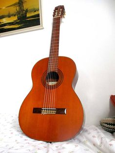 Suzuki 1665 1971 vintage classical guitar Japan (amazing tone) Label stamp 17763 Neck stamp 711010 (dates the guitar to Lam cedar top Lam bubinga Classical Guitars, Classical Music, 50 Years Old, Over The Years, Guitar Bag, Studio Gear, Sounds Great, Price Point, Nagoya