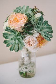 succulent and floral bouquet, photo by Nathan Russell Photography http://ruffledblog.com/round-mountain-texas-wedding #weddingbouquet #flowers