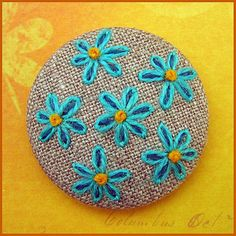 Embroidered button/brooch by Birthine, via Flickr