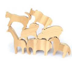 Set of safari animals wooden toys 7 animals including an elephant, a zebra, a giraffe, a rhino, a hippo, a lion and a leopard. Your child will have hours of fun playing with these figurines. The pieces are made of solid pine wood. The safari animals have been hand cut and varnished with an organic varnish (certified toy safe). All the pieces have been sanded and the edges rounded to make it soft for childrens little hands. All the wood comes from sustainably managed forests (FSC certified)…