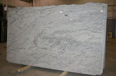 River White Granite - This could be a more practical solution to Carrera marble in the kitchen!