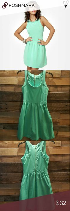 GIRLY MINT GREEN SKATER DRESS LULU SKATER DRESS WORN A FEW TIMES EXCELLENT CONDITION SEMI- STRETCHY MATERIAL COLOR MINT GREEN SIZE M 7/8 85% NYLON, 15% SPANDEX SIDE INVISIBLE WORKING POCKETS RACEBACK WITH GOLD EXPOSWS ZIPPER TAG TAKEN OUT(ITCHED) NICE SEMI -THICK MATERIAL FUN FLIRTY GIRLY DRESS! SO CUTE! GREAT COLOR! *NO TRADES NO RETURNS* Lulu Dresses Mini