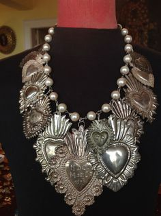antique silver corazon milagros on faux pearl necklace. at thelushlifeantiques.com