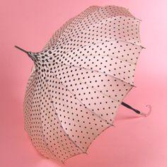 pink pagoda umbrella with black polka dots