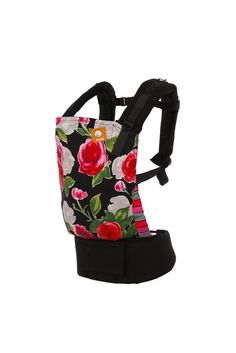 Juliette - Tula Baby Carrier. Rich, bold colors make Juliette a stunning beautiful display! Juliette has exquisitely illustrated roses in red, white, and fuchsia with patterned leg padding on black canvas. Juliette is a delicate surprise to the eye with a timeless style.