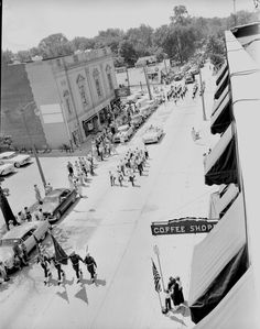 Aerial view of the 4th of July Parade on Main Street, 1955. Taken from the roof of the Mayflower Hotel.