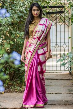 Such a french shade of mauve pink this! Another stylish half and half saree with shibori dyed half in pink white. A fresh mauve pink semi matka drape with detail magic in the form of a gold border. Don this drape and just be gorgeous.Team it with a gold blouse or a white blouse and go places! Or even don a mauve pink blouse to pull off a one tone look. #houseofblouse #saree  #blouse #indianwear #india #fashion #bollywood #mauve #pink #shibori #halfandhalfsaree