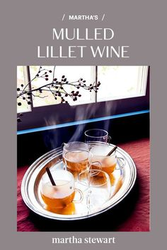 The aromatic aperitif wine Lillet Blanc is simmered with two kinds of citrus (orange and lemon) and a bevy of spices (black pepper, cinnamon, cloves, and cardamom) for this festive, warming drink. #mulledwine #wine #marthastewart #drinkrecipes