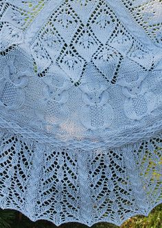 Free Knitting Pattern for Into the Woods Owl Shawl - This half-round lace shawl combines cable and lace stitches to form forest motifs. Deisgned by Marva Maida. Pictured project by Ancalima