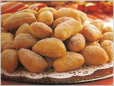 Pampushky. Ukrainian doughnuts dusted with sugar and filled with rose preserves. Taste light and airy and smell like summer. Yummm.