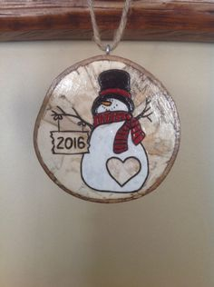 A personal favorite from my Etsy shop https://www.etsy.com/listing/268226072/2016-personalized-snowman-ornament