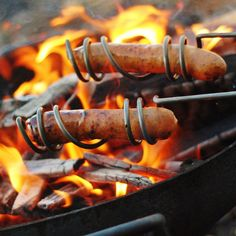 The Curly Dog Roasting Sticks are an ingenious grilling device to help make roasting hot dogs a snap.