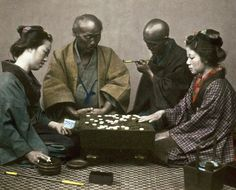 Perhaps the most popular board game in Japan during the Meiji period was 'Go'. Hand-colored photo, 1870's, Japan. By Felice Beato